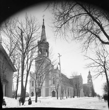 The old St. Joseph's church, on Wilbrod Ave. at the corner of Cumberland St., before it burned down in 1930 and was replaced by the church which now stands there. In the background is the first Sacré Coeur church on Laurier Ave. E. That church burned down in 1907 and again in 1978. This picture was taken in March 1904. Note the snowbank on the left. LAC MIKAN 3325444