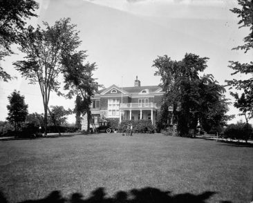 The grounds and residence of the Rt. Hon. Robert Laird Borden on 201 Wurtemburg St., June, 1915. The high-rise Watergate apartment building now stands on this spot. Although the house is just north of Rideau St., the district was considered part of Sandy Hill until at least the 1930s. Borden lived here for 30 years between 1907 and 1937. The Bordens landscaped the back garden that descended to the Rideau River. Topley Series E @ LAC (topley-1), Ottawa scenes from Series E, pages 5.04 and 5.05