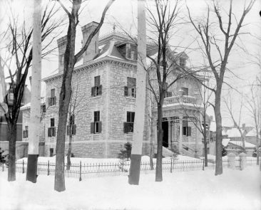 565 Rideau Street, as it looked in January 1901. The contractor M.P. Davis (brother to William H.) lived in a mansion large enough to host splendid parties as this report in the January 26, 1907 edition of Toronto Saturday Night attests:  …Mrs. M.P. Davis … was the hostess of a particularly smart and delightful house-dance, in which all the young people of the capital's four hundred [400 was said to be the number of guests that Lady Astor in New York could fit in her ballroom], as well as many guests who are in town just now, participated. The spacious ballroom in the basement provided ample room for the large number of dances, and was beautifully decorated and brilliantly lighted, quantities of red and white carnations being in evidence in every available nook and corner.  M.P.'s son William lived in an equally-grand house at 407 Wilbrod (now Australia House).  A third contractor, George Goodwin, built for himself the house at 312 Laurier Ave. E. which is now the Canadian headquarters of Amnesty International. Topley Series E @ LAC (topley-1), item 106 of 301
