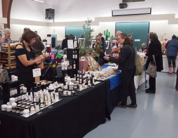 2.	Artisans and shoppers in the Main Hall. Kate McGovern of Sweet Fern Canada and her hand-made cosmetics.