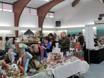 3.	More tables in the Main Hall. Cuddly fabric toys of Liv.Well Toys and enticing sweets of K & L Chocolate and Gift Wrapping.